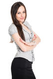 Confident brunette with her hands folded Royalty Free Stock Images