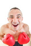 Portrait of a confused and astonished man with red boxing gloves Stock Photography