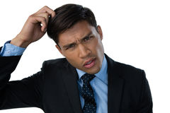 Portrait of confused businessman. With hand in hair Stock Images