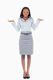 Portrait of a confused businesswoman. Against a white background Royalty Free Stock Photography