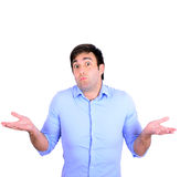 Portrait of confused clueless young man against white background Stock Images