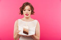 Portrait of a confused girl holding plate Royalty Free Stock Image