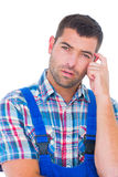 Portrait of confused manual worker scratching head Stock Photos