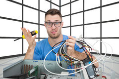 Portrait of confused it professional with driver and cables in front of ope. Composite image of portrait of confused young it professional with driver and cables stock photography