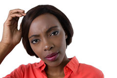 Portrait of confused woman. Against white background Royalty Free Stock Image