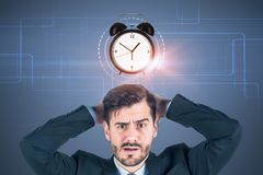 Confused businessman, alarm clock royalty free stock photos