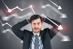 Confused businessman, falling graphs royalty free stock photo