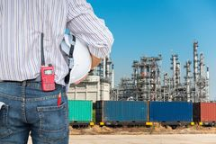 Portrait of construction engineer with Oil and Gas refinery plan Royalty Free Stock Photography