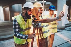 Portrait of construction engineers working on building site Stock Photo