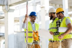 Portrait of construction engineers working on building site Royalty Free Stock Images