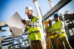 Portrait of construction engineers working on building site Royalty Free Stock Photo