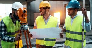 Portrait of construction engineers working on building site royalty free stock image