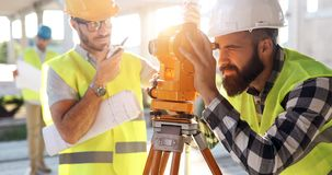 Portrait of construction engineers working on building site. Together stock photos