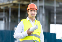 Portrait of construction manager posing against scaffolding Stock Photo