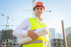 Portrait of construction manager posing with blueprints Royalty Free Stock Images