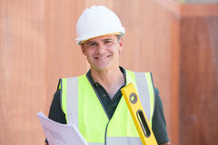 Portrait Of Construction Worker On Building Site With House Plan Royalty Free Stock Images