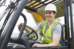Portrait Of Construction Worker Driving Digger Stock Photos