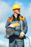 Portrait of construction worker with grinder Royalty Free Stock Image
