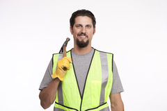 Portrait of a construction worker with a hammer Stock Images