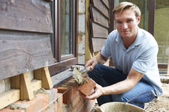 Portrait Of Construction Worker Laying Bricks Royalty Free Stock Images