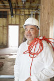 Portrait of a construction worker with a red electric wire Royalty Free Stock Images