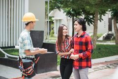 Construction worker welcoming the house owner. Portrait of construction worker welcoming the house owner. buy new house concept. buyer Royalty Free Stock Photos