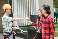 Construction worker welcoming the house owner. Portrait of construction worker welcoming the house owner. buy new house concept. buyer Royalty Free Stock Photography