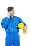 Portrait of a constuction worker talking on phone Royalty Free Stock Photos
