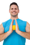 Portrait of a content young man holding stress ball Stock Image
