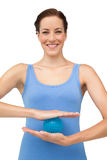 Portrait of a content young woman holding stress ball Royalty Free Stock Photography