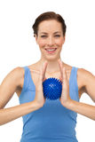 Portrait of a content young woman holding stress ball Royalty Free Stock Images