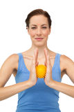 Portrait of a content young woman holding stress ball Stock Images