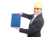 Portrait of contractor wearing hardhat holding blue cardboard Royalty Free Stock Photos