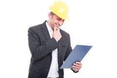 Portrait of contractor wearing hardhat holding clipboard Stock Photo