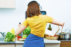 Portrait of cooking woman in kitchen. Girl standin Royalty Free Stock Photos