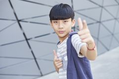 Portrait of cool Asian kid posing outdoors Royalty Free Stock Photos