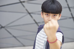 Portrait of cool Asian kid posing outdoors Stock Photos