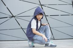 Portrait of cool Asian kid posing outdoors Stock Image