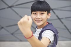 Portrait of cool Asian kid posing & smiling outdoors stock photography