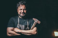 Cool blacksmith portrait in workshop Stock Photography