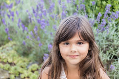 Portrait of cool brunette little girl with lavender Stock Photo