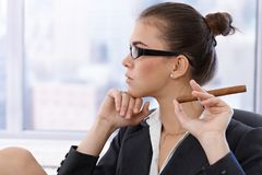 Portrait of cool businesswoman with cigar Stock Photos
