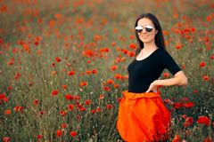 Portrait of a Cool Fashion Woman in a Field of Poppies stock photo