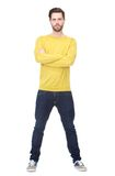 Portrait of a cool guy standing with arms crossed. Full length portrait of a cool guy standing on isolated white background with arms crossed Royalty Free Stock Images