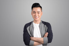 Portrait of cool handsome asian man with arms crossed.  Stock Photography