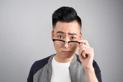 Portrait of cool handsome asian man with arms crossed.  Royalty Free Stock Image