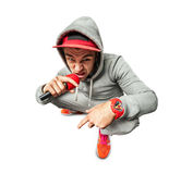 Portrait of cool looking singing hiphopper in sportswear. Royalty Free Stock Images