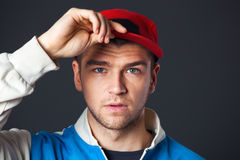 Portrait of cool looking young guy posing in studio. Royalty Free Stock Photography