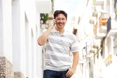 Cool man walking in the city and making a phone call Stock Image