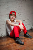 Portrait of cool young hip hop boy in red hat and red pants Stock Images